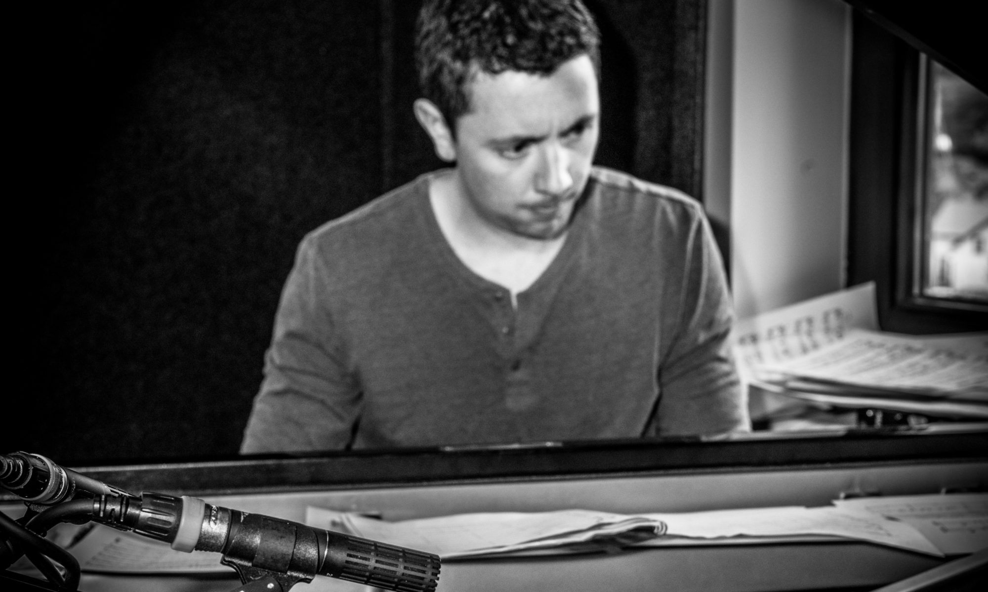 B&W image of Cormac at the piano